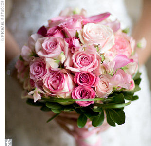 Bridesmaid bouquet of pinks with dark green foliage.jpg